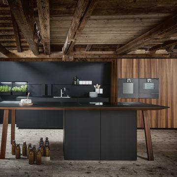 Designküche Next125 in Onyxschwarz matt mit Arbeitstisch als Kochinsel, Bora Kochfeldabzug PURU
